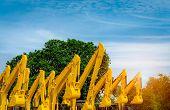 Yellow Backhoe With Hydraulic Piston Arm. Huge Metal Bulldozer. Excavator Machine. Hydraulic Machine poster