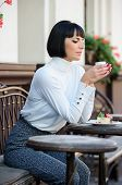 Woman Attractive Elegant Brunette Enjoy Dessert And Coffee Cafe Terrace Background. Pleasant Time An poster