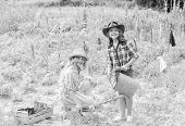 Sisters Together Helping At Farm. Girls Planting Plants. Agriculture Concept. Rustic Children Workin poster