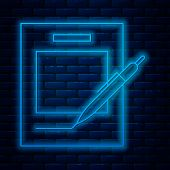 Glowing Neon Line Blank Notebook And Pen Icon Isolated On Brick Wall Background. Paper And Pen. Vect poster