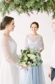 Leading Or Master Of Ceremonies, Bride And Groom At Wedding Ceremony With Decorations And Pine Arch  poster
