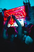 Crowd At A Music Festival. People Listen To Music And Have Fun. Concert. Stage With Artist. Blur Eff poster