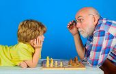 Checkmate. Child Boy Playing Chess With Grandfather. Games And Activities For Children. Grandfather  poster