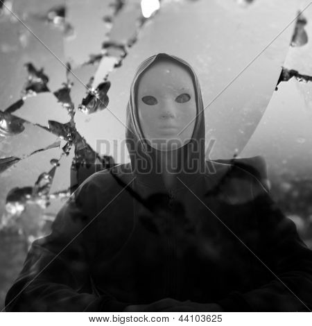 Masked Figure Broken Mirror