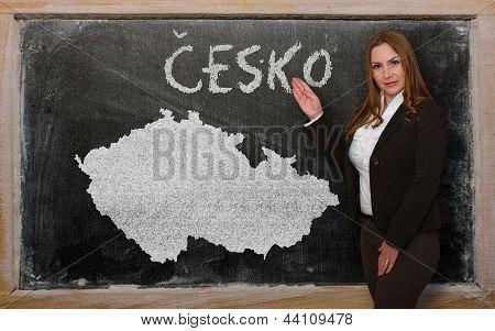 Teacher Showing Map Of Czech On Blackboard
