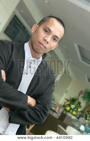 Man In Waiter Uniform