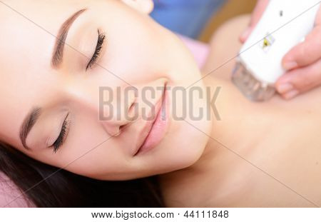 young woman getting electrostimulation lifting therapy, beauty treatment