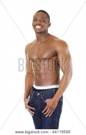 Happy well-built muscular black man in jeans, isolated on white