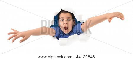 Surprised boy looking through paper hole isolated on white background