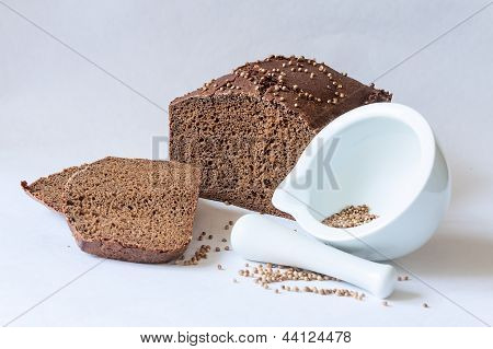 Traditional Russian Black Bread With Coriander Seeds With Mortar Spice