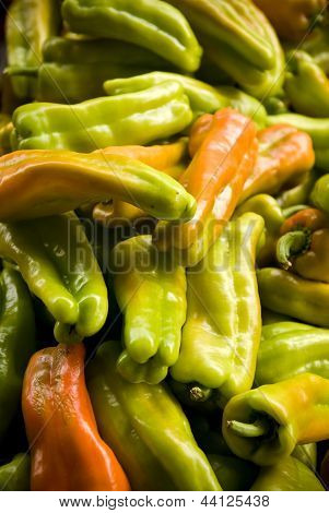 A pile of banana peppers
