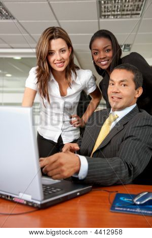 Business Team On A Laptop
