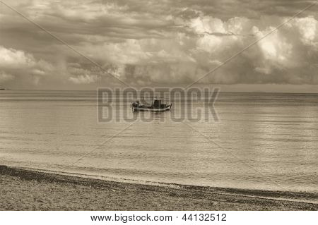 A Small Boat At Sea