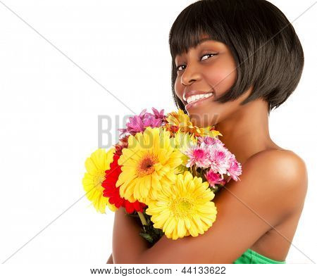 Charming African girl with fresh flowers bunch isolated on white background, studio shot, copy space