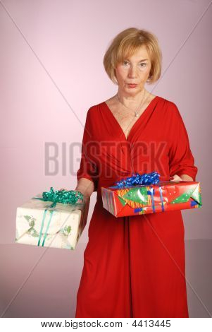 Attractive Older Woman Holding Gifts