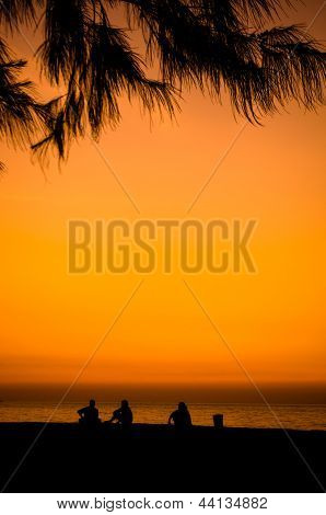 Silhouette Of A Happy Family On The Beach