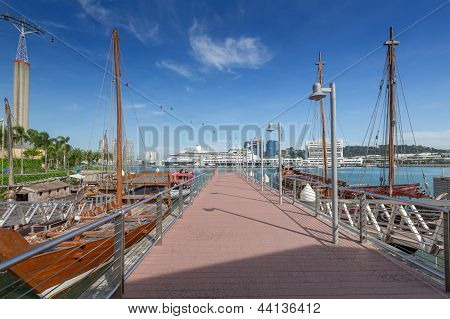 Small Pier With Old Boats Near Sentosa Area In Singapore