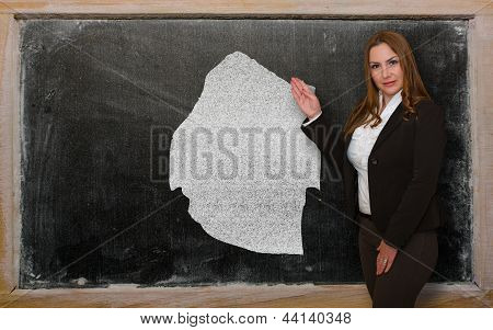 Teacher Showing Map Of Swaziland On Blackboard