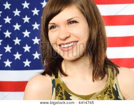 Happy Girl Opposite An American Flag