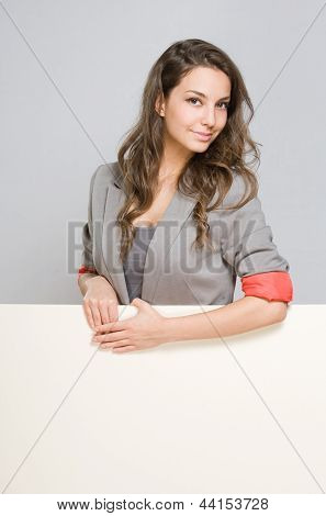 Elegant Young Businesswoman With Blank White Sign.
