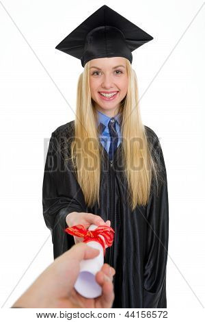 Smiling Young Woman In Graduation Gown Receiving Diploma