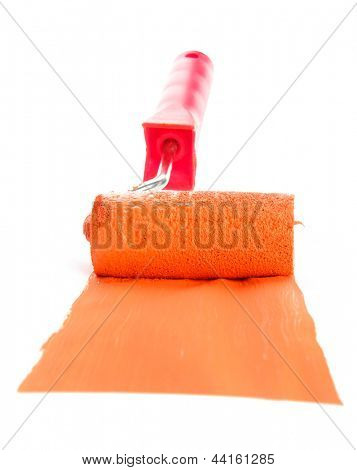 roller with orange paint isolated on white