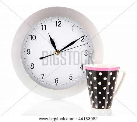Cup tea and clock isolated on white