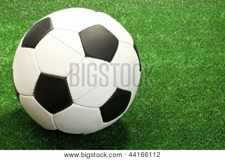 football ball on artificial green grass