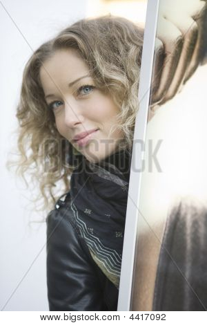 Portrait Of Young  Curl Girl Standing On The Shop-window.