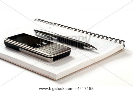Pen, Phone And Notepad