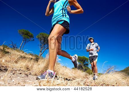 marathon running athletes couple training on trail fitness sport active lifestyle