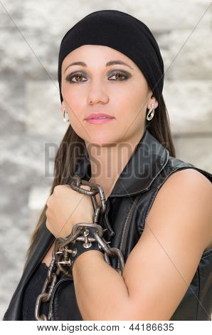 attractive brunette in black, gang member