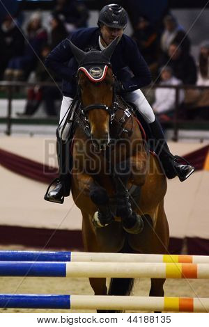 KAPOSVAR, HUNGARY - MARCH 24: Vida Vojtec jumps with his horse (Polinetta) on the Masters Tournament International Jumping Competition, March 24, 2013 in Kaposvar, Hungary