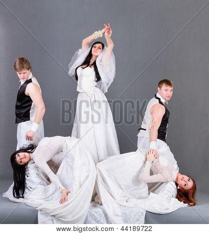 Actors in the wedding dress posing.