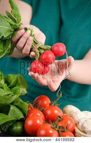 Woman Holding Fresh Vegetables