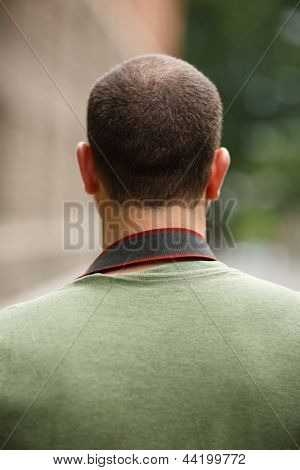 Portrait of incognito man, back view.