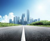 stock photo of skyscrapers  - Asphalt road and modern city - JPG