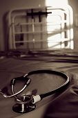 foto of mrsa  - image of a depressing empty hospital bed with a doctors stethoscope in the foreground - JPG