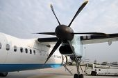 pic of rotor plane  - Side propeller of the plane with airplane at the airport - JPG