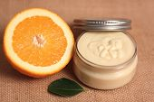picture of body-lotion  - Homemade orange body butter on burlap background - JPG
