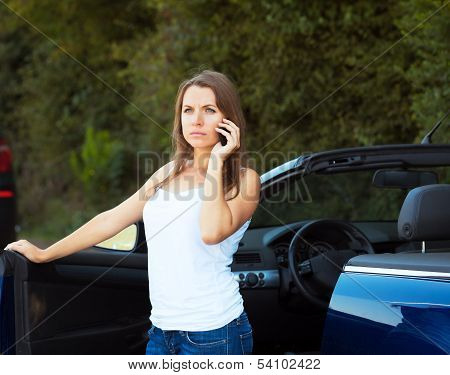 Caucasian Girl On A Cell Phone Service Or Tow Truck Traffic Near The Cabriolet