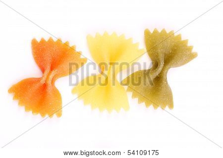 Farfalle pasta, isolated, three colors.