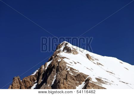 Mountain Top With Snow And Cloudless Blue Sky In Nice Day