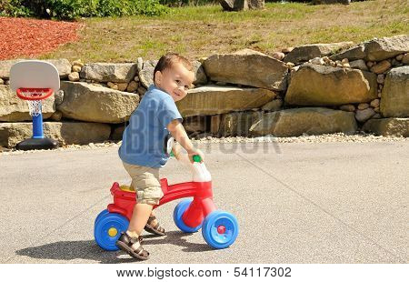 Toddler Riding Tricycle