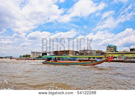 typical long tail boat down Chao Praya river in Bangkok