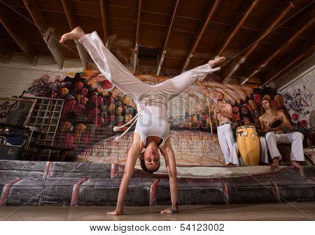 Woman In Split Handstand