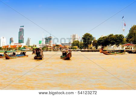 long tail boats down Chao Praya river in Bangkok