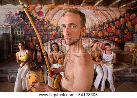 Capoeira Performer Playing Music