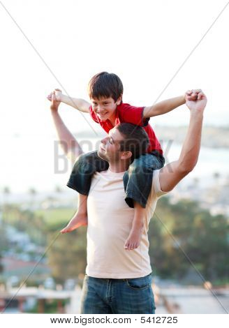 Father Giving His Son Piggyback
