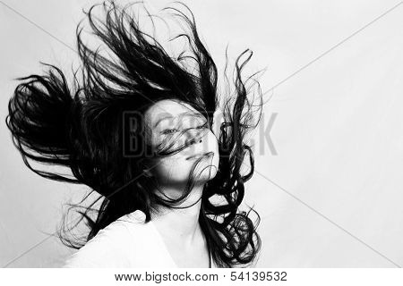 Young woman flicking hair